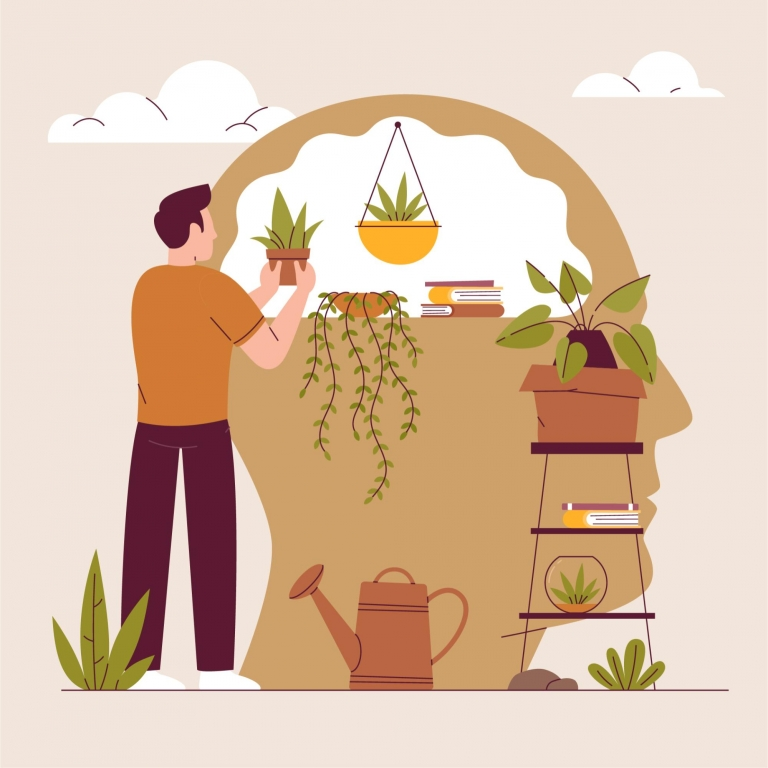 Man taking care of plants in a head-shaped planter